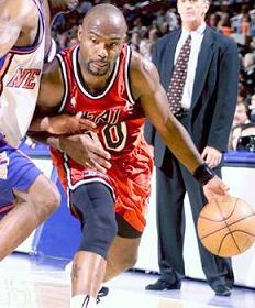 Tim Hardaway using his shoulder to withstand the defender's pressure